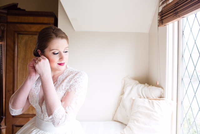 Wedding Morning Photos with Bride Putting on Jewelry. Bridal hair and makeup by Vanity Belle in Orange County (Costa Mesa) and San Diego (La Jolla)