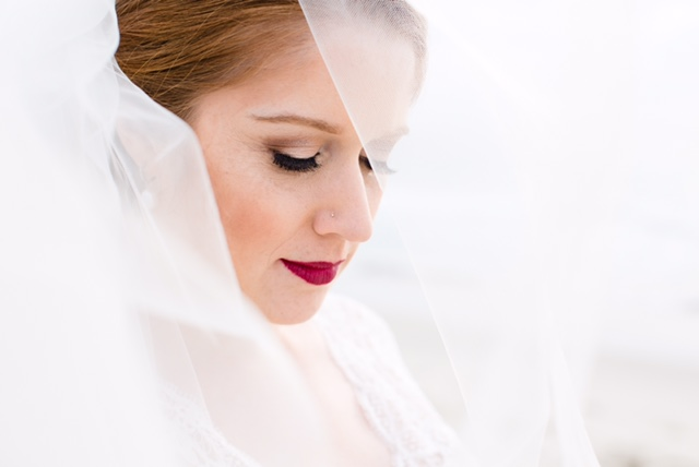 Wedding Day Photo with Redhead Bride in Veil Wearing Red Lipstick and Eyelash Extensions. Bridal Hair and Makeup by Vanity Belle in Orange County (Costa Mesa) and San Diego (La Jolla)