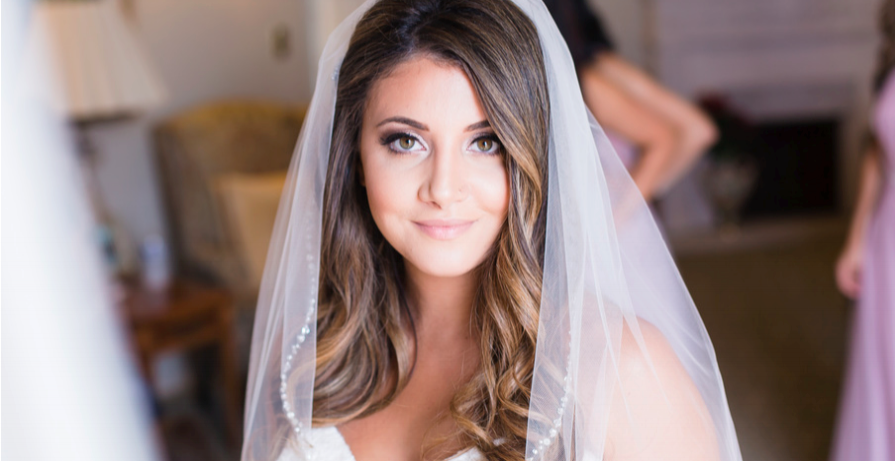 Brunette Bride with Curled Hair Down and Veil. Wedding Day hairstyles and Makeup by Vanity Belle in Orange County (Costa Mesa) and San Diego (La Jolla)