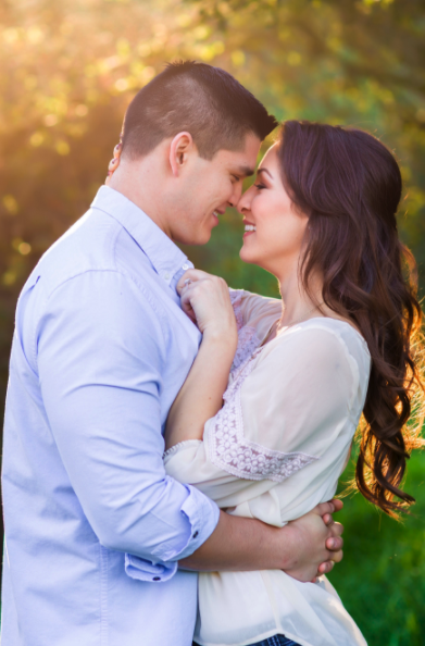 Couples Hugging in Engagement Photos with Hair and Makeup. Hair and Makeup done by Vanity Belle in Orange County (Costa Mesa) and San Diego (La Jolla).