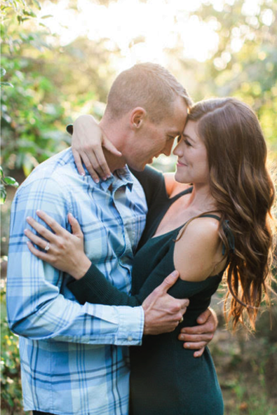 Engagement Photos in Nature with Couple Hugging and Looking into Eyes. Hair and Makeup done by Vanity Belle in Orange County (Costa Mesa) and San Diego (La Jolla).