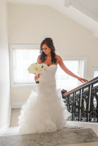 Wedding Photos with Bride Walking Up Stairs with Bouquet. Bridal Hair and Makeup by Vanity Belle in Orange County (Costa Mesa) and San Diego (La Jolla)