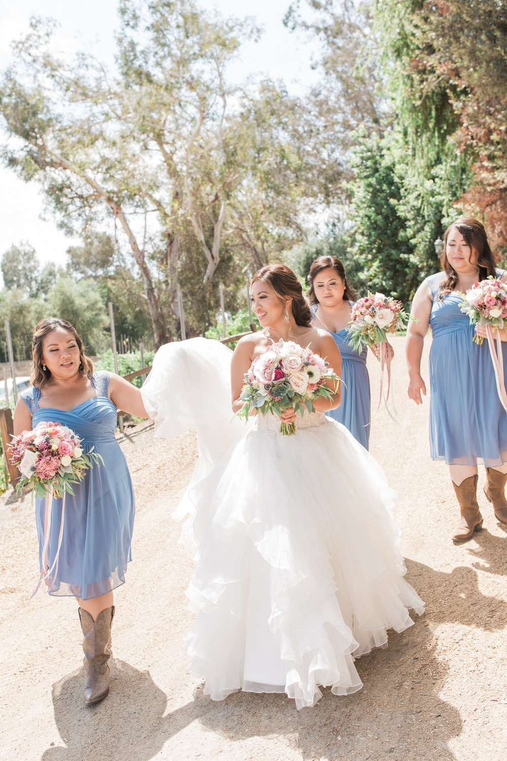 """How gorgeous are these three Bridesmaids in their blue sheath dresses! According to Country Living , gone are the days of triple-digit bridal parties lined in a row wearing long heavy gowns. When it comes to 2017 """"Country Wedding Trends That Are Going to Be Huge This Year,"""" a triplet of maidens is a perfect, intimate size to get your matrimony hoedown started!"""