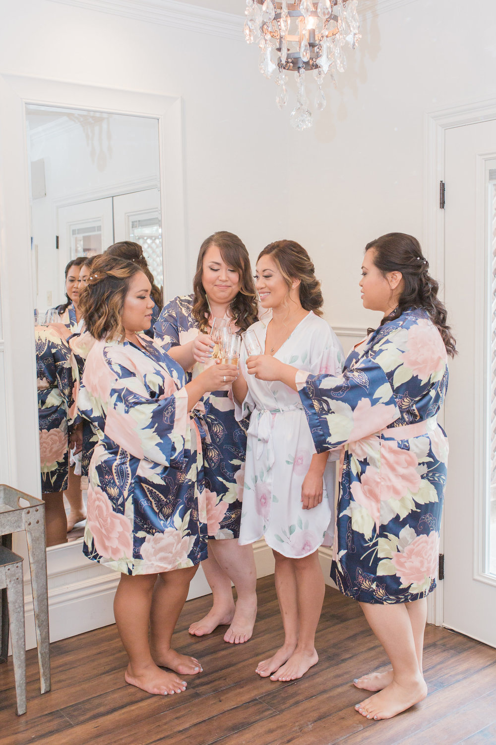 Satin Bridal robes are the perfect gifts and they look amazing in your getting-ready photos. Cheers to the Bride - to - Be!