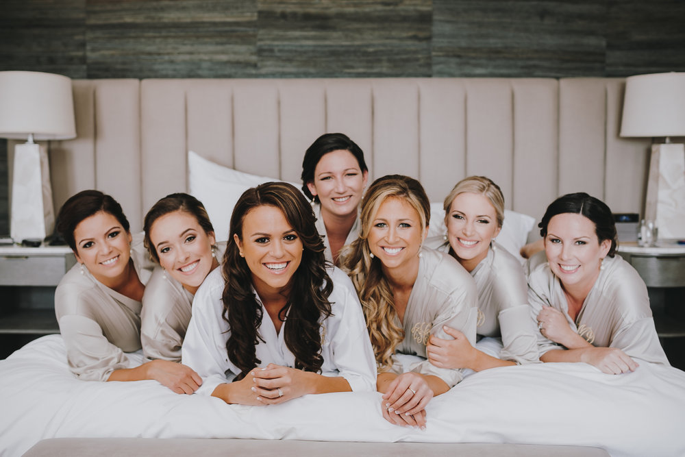 Check out this gorgeous Bridal party! Even the smallest personal touch can make all the difference. For instance, we love how all the bridesmaids wore their hair up, except for the Maid of Honor, next to the Bride, who wore her hair completely down.