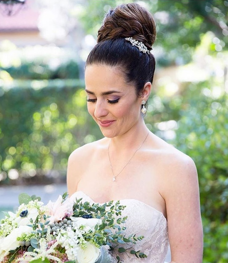 The high ballerina bun is a an elegant and classic bridal look. Incorporating an ornate hair piece or even a headband gives it an even more unique look.