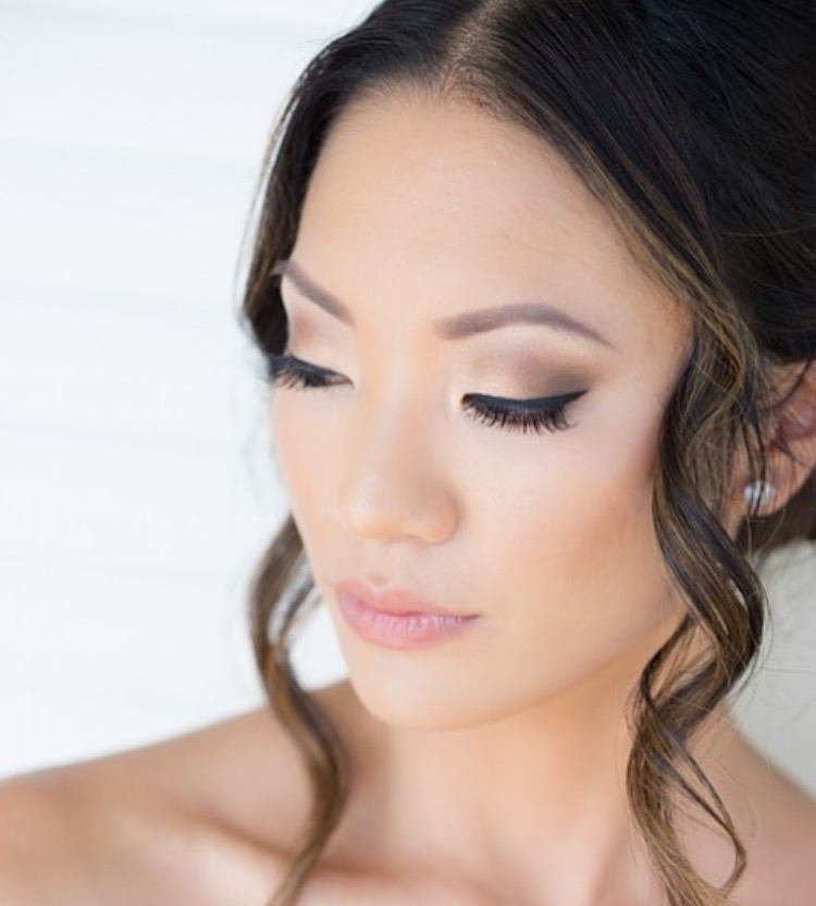 """Match an earthy toned palette for your smokey eyes with a highlighter cream to your cheek bones and it will truly give you that """"wedding glow."""" Photo Credit: JimKennedyphotographers"""