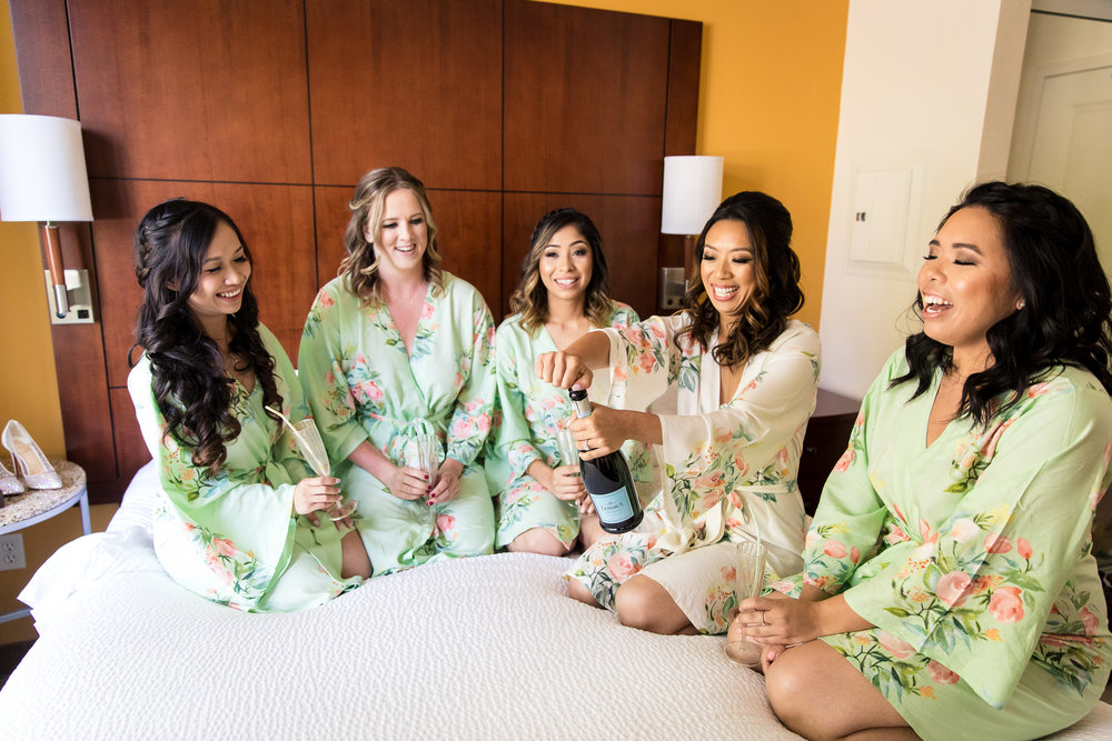 POP The champagne ladies..she's changing her last name! How gorgeous are these soft green and floral Bridesmaids robes?