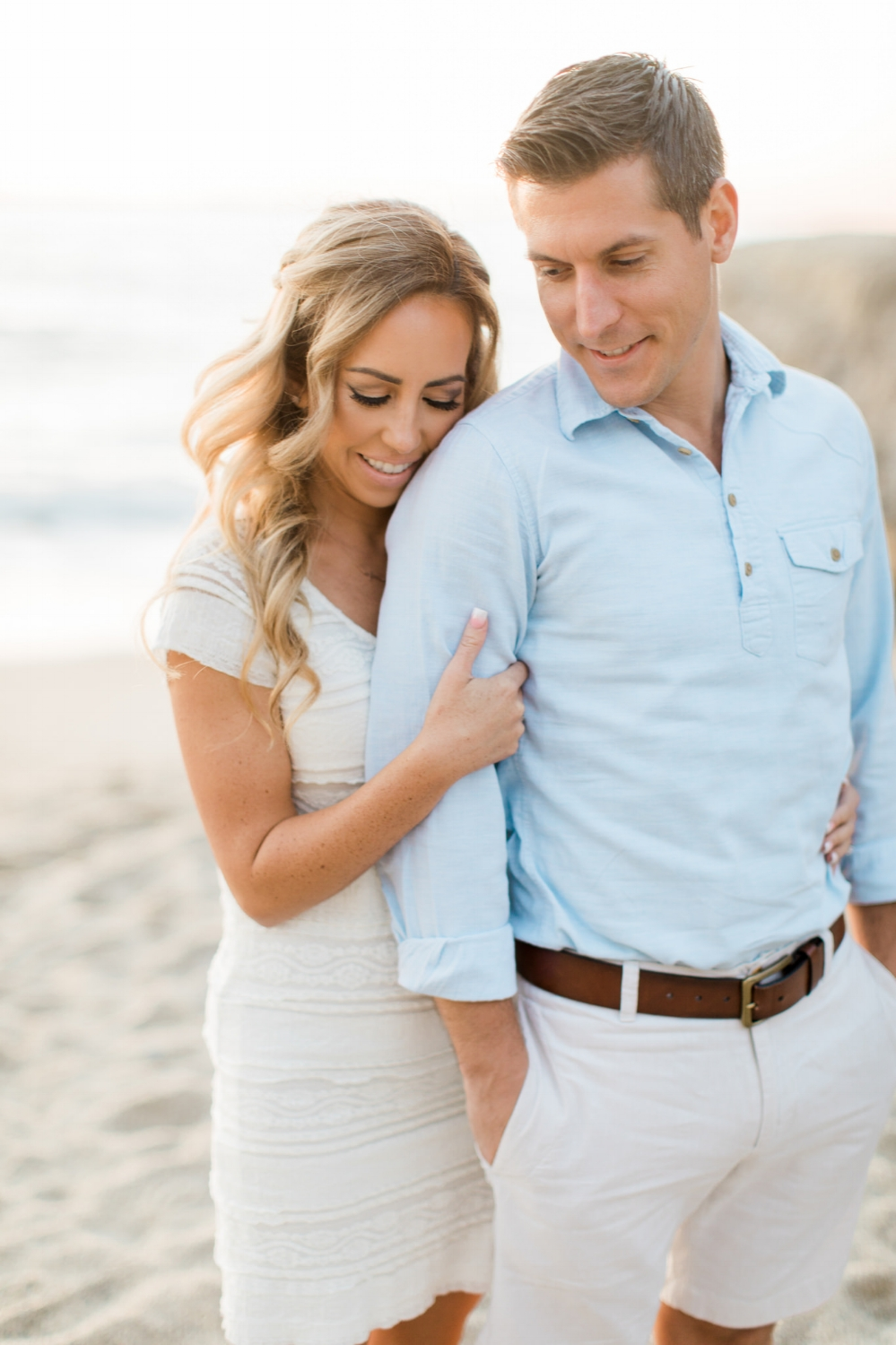 Romantic Engagement Photos at Beach. Hair and makeup by Vanity Belle in Orange County (Costa Mesa) and San Diego (La Jolla)