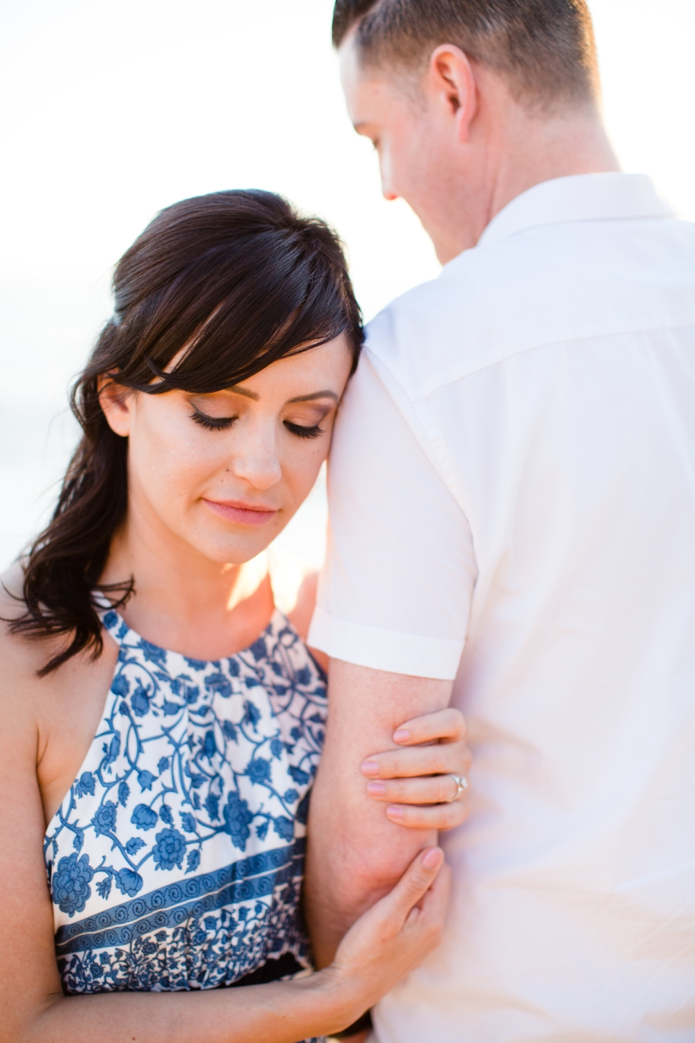 Romantic Engagement Photography with Simple Ring and Eyelash Extensions. Hair and Makeup by Vanity Belle in Orange County (Costa Mesa) and San Diego (La Jolla).