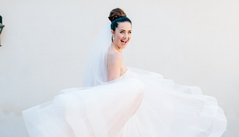 Brunette Bride Twirling Dress with Braid Updo and Veil + Makeup for Blue Eyes. Bridal beauty by Vanity Belle in Orange County (Costa Mesa) and San Diego (La Jolla)