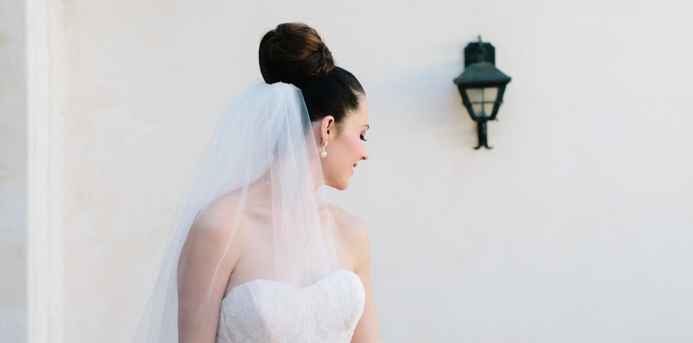 Brunette Bride with Braid Updo and Veil + Makeup and Eyelash Extensions. Bridal beauty by Vanity Belle in Orange County (Costa Mesa) and San Diego (La Jolla)