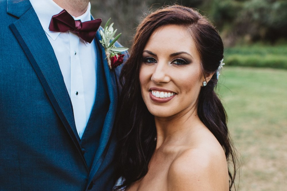 Brunette Bride with Long Hairstyle Down and Smokey Eye Makeup in Outdoor Wedding Photos. Bridal hair and makeup by Vanity Belle in Orange County (Costa Mesa) and San Diego (La Jolla)