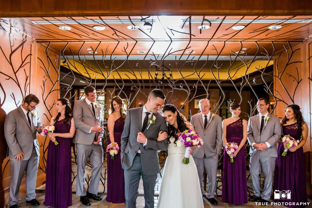 What a unique and creative back drop to this stunning photo with their bridal party.