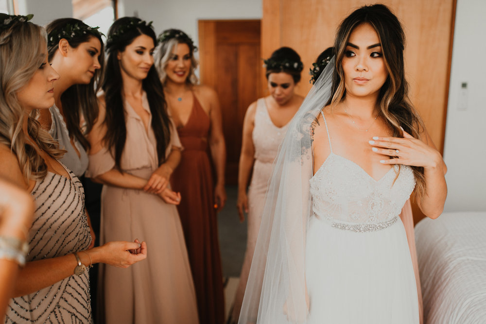 Asian bride with bridesmaids, wedding days hair and makeup, flower crowns, boho style makeup. Wedding hair and makeup by Vanity Belle in Orange County (Costa Mesa) and San Diego (La Jolla).
