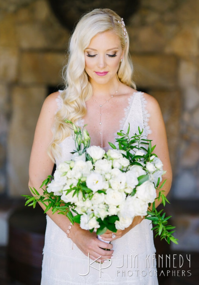 Blonde half updo wedding/bridal hair and makeup by Vanity Belle Orange County (Costa Mesa) in Los Cabo Mexico