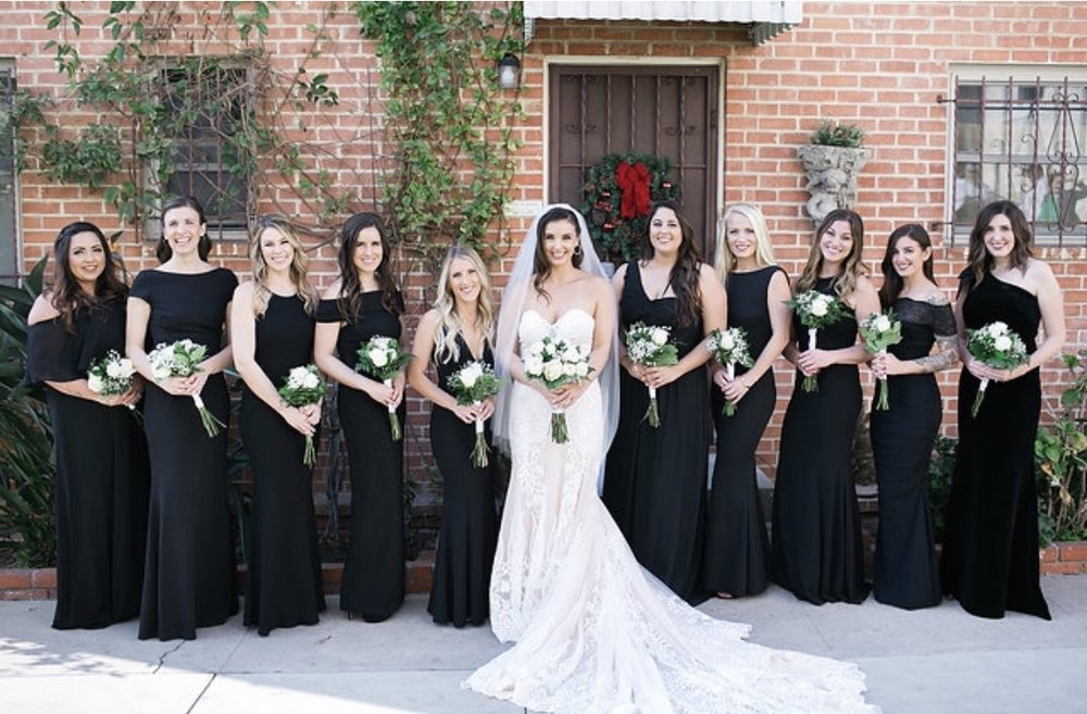 Bride and Bridesmaids wedding day photo with long wavy curls and smokey eyes. Bridal hair and makeup by Vanity Belle in Orange County (Costa Mesa) and San Diego (La Jolla). thevanitybelle.com