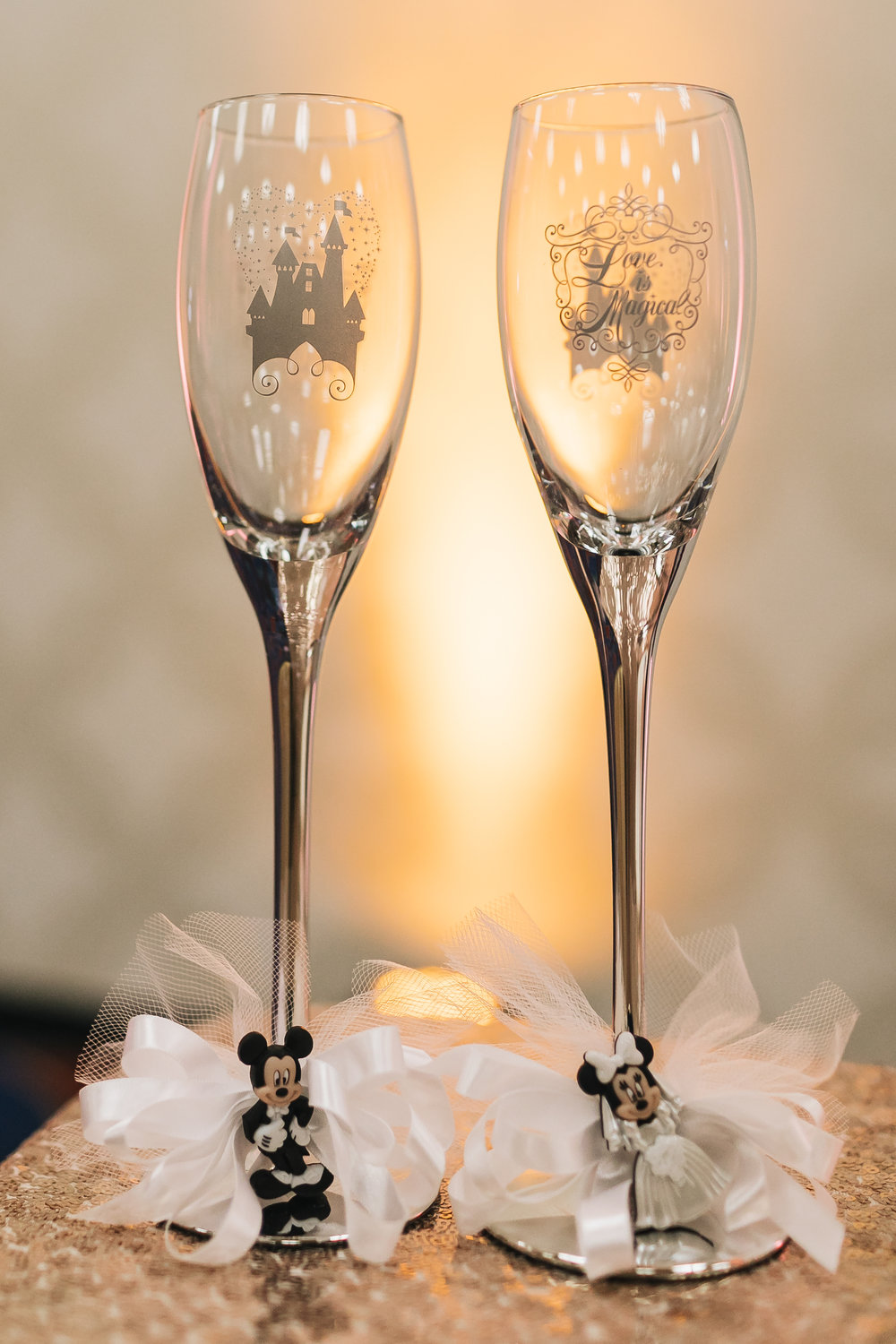 Disney wedding customized decor, champagne flutes photographed by Analisa Joy Photography. Wedding Beauty by Vanity Belle. www.thevanitybelle.com