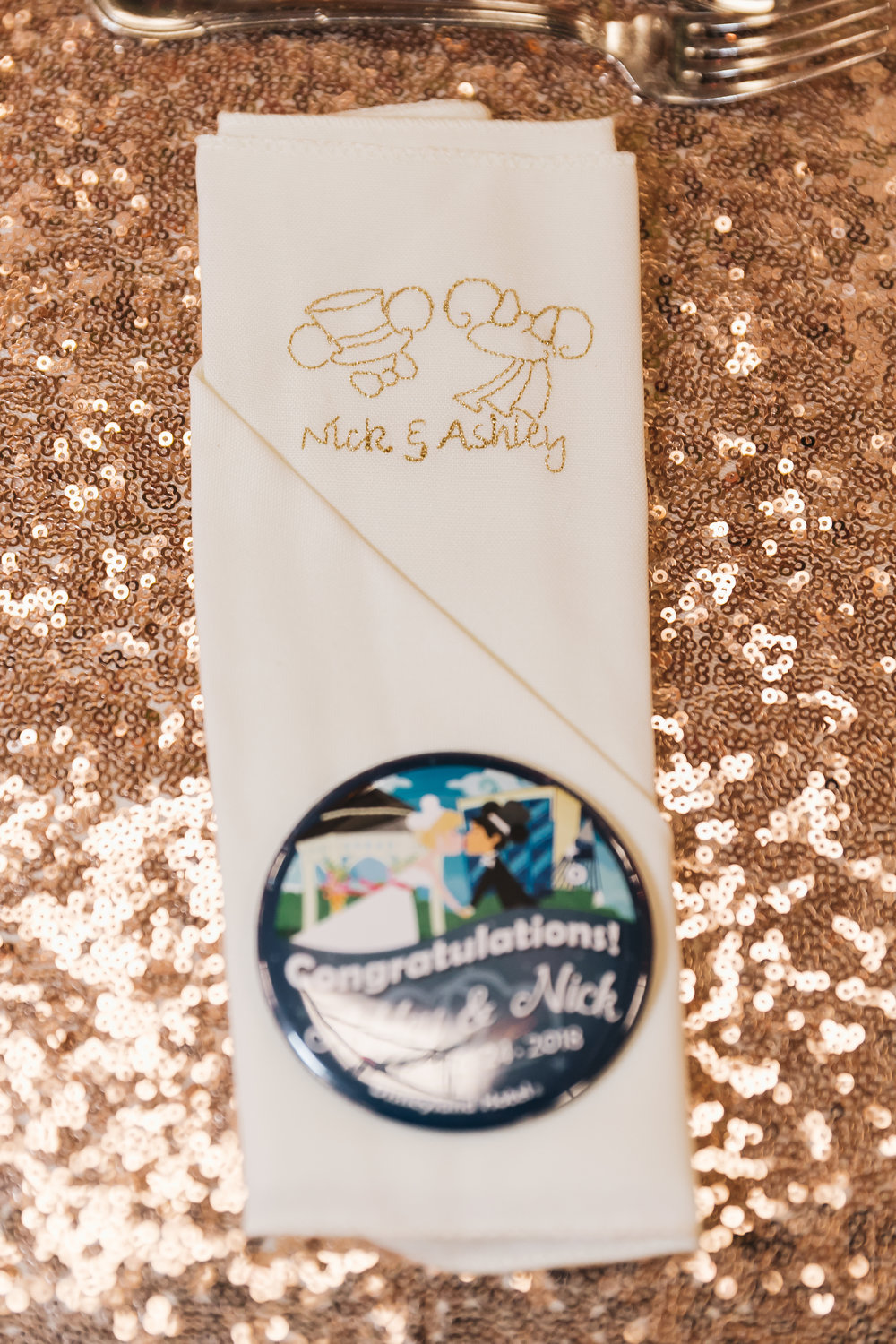 Customized Disney wedding napkin photo by Analisa Joy Photography. Wedding Beauty by Vanity Belle. www.thevanitybelle.com