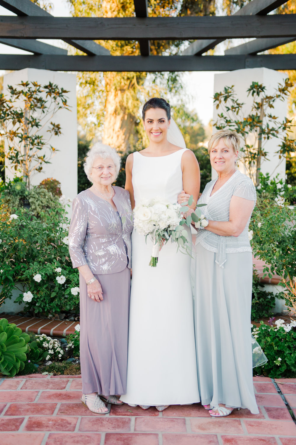 Three generations wedding photo by Taryn Grey Photography. Bride with mother of the bride and grandmother of the bride. Wedding hair and makeup by Vanity Belle in Orange County (Costa Mesa) and San Diego (La Jolla) thevanitybelle.com