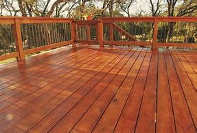 patio staining - Before staining your deck, be sure the wood is dry and free of contaminants. Stain that's applied to damp surfaces won't adhere well and can crack or peel. Clean wood is important, too-the surface should be free of mildew stains, dirt, debris and contaminants. This is why we power spray and apply cleaner.