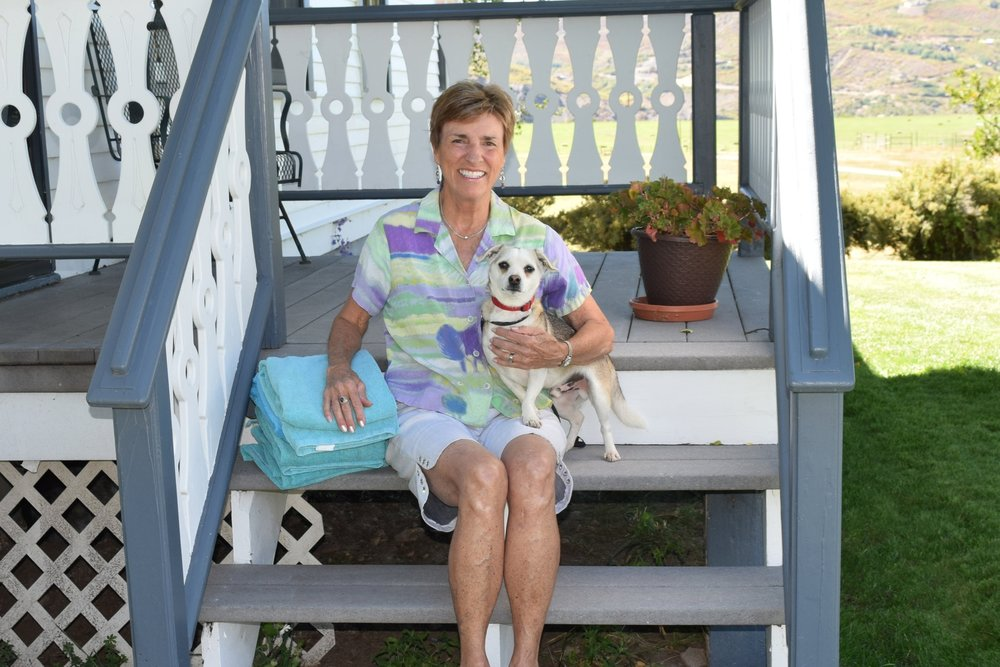 Thrift Shop volunteer Carolyn Moore dropped off towels and came home with Bug.