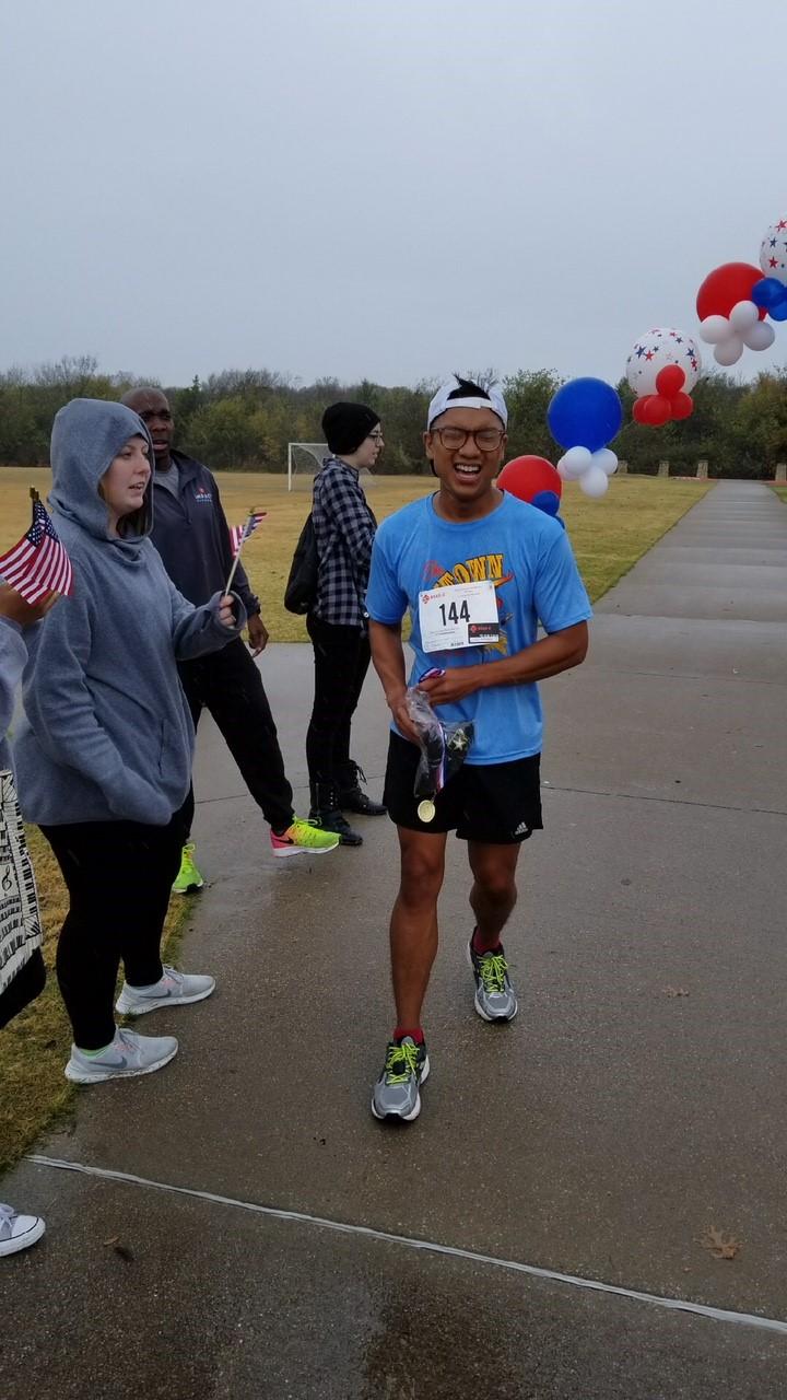 Charles Pantangco won 1st place on the 5k Fun Run.jpg
