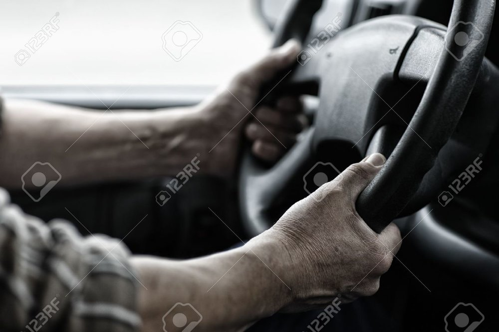 16460549-Male-driver-hands-holding-steering-wheel--Stock-Photo-truck.jpg