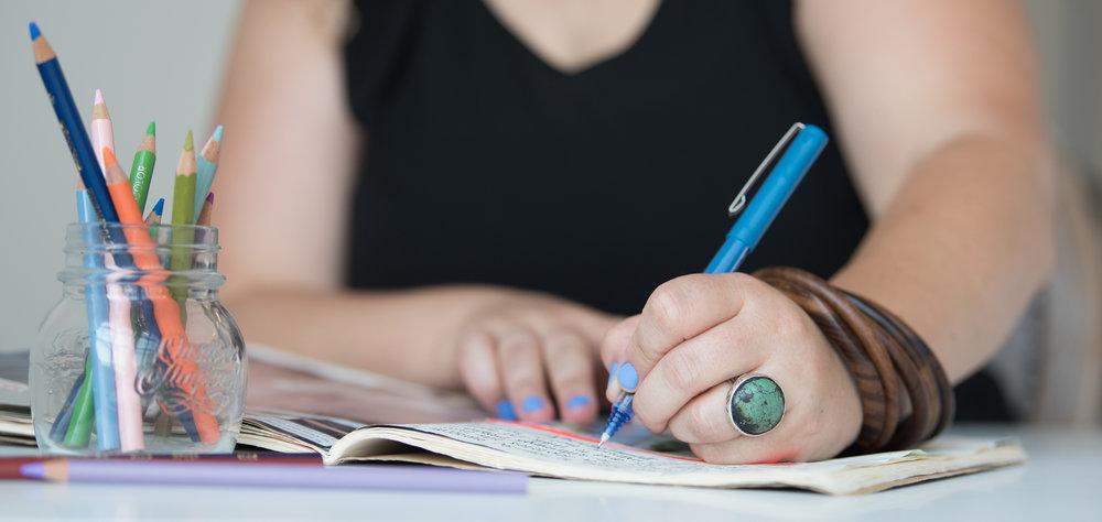 anya writing blue pen.jpeg