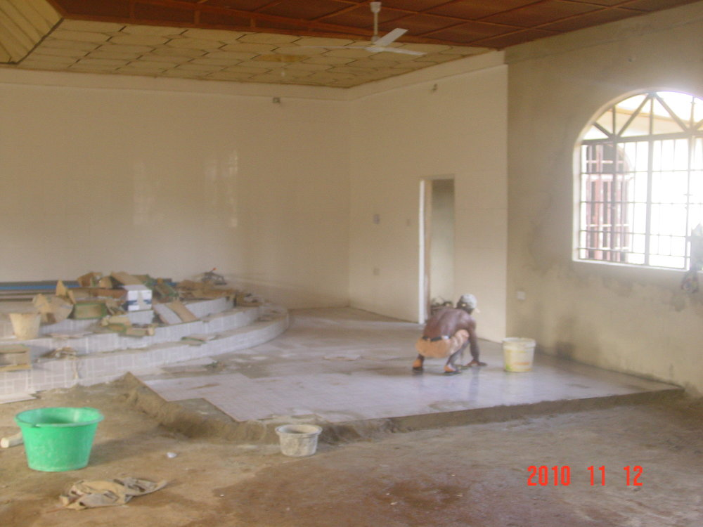 tiling commence in main hall.JPG