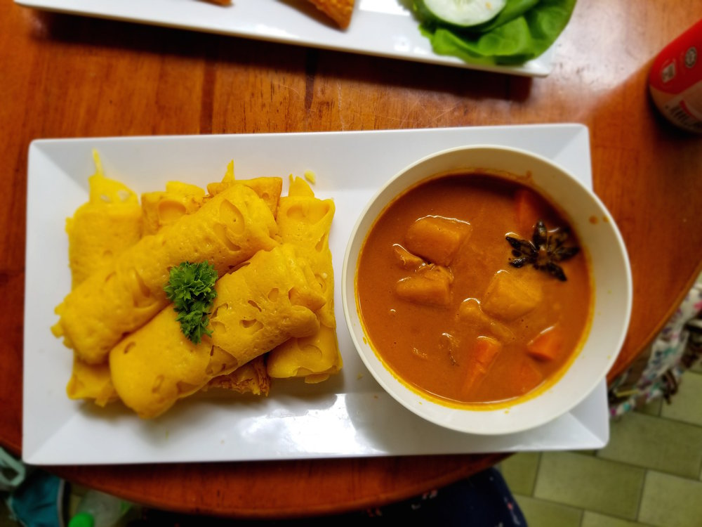 Roti Jala  - This particular version of Roti Gala happened with be vegetarian.  It was loaded with perfectly cooked potato, pumpkin, and carrots and was extra spicy.  The bread has the consistency of a crepe and the lightness of injera.