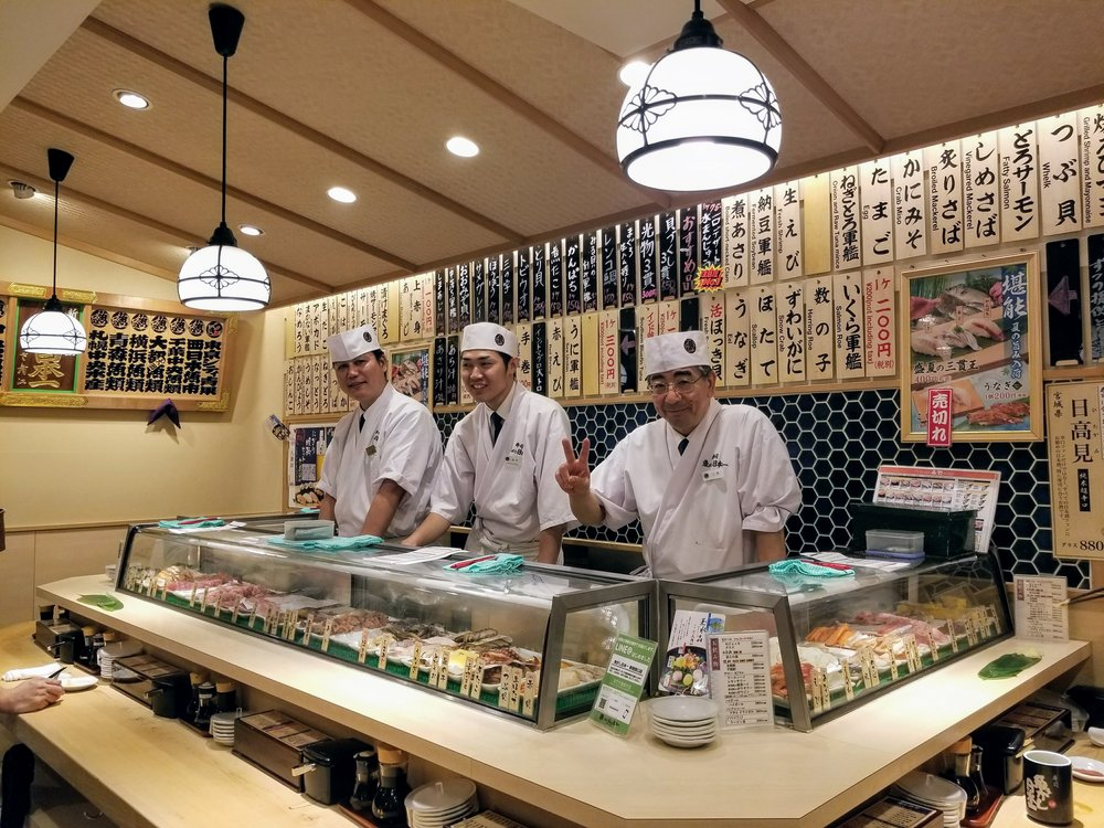 This tiny, friendly, sushi shop, is literally standing room only.