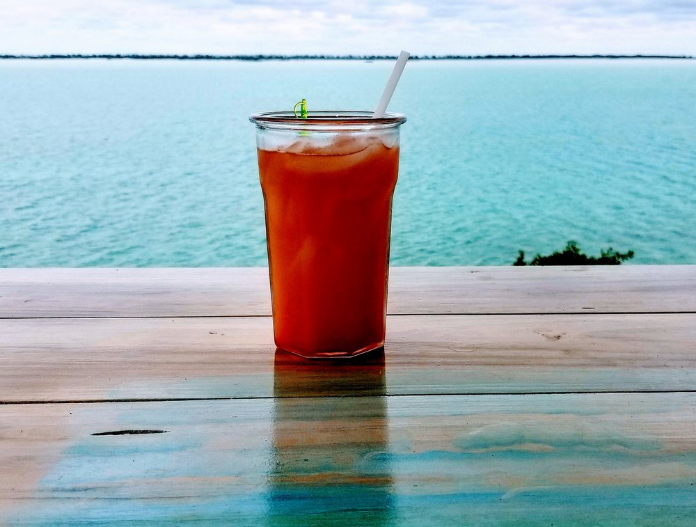 Howard's Rum Punch at the Last Stop Bar and Grill on North Caicos contains his secret ingredient and views for days off their back porch.