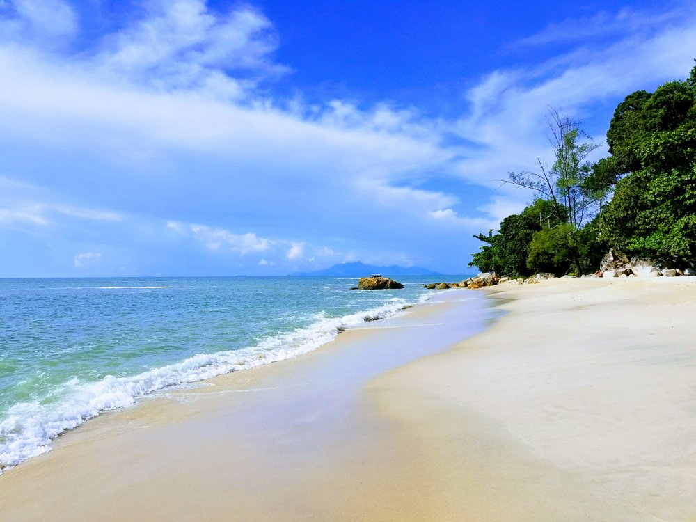 One of the many beaches in Penang. Caution- Jellyfish roam in and out the water, ask locals if it's safe to jump in.