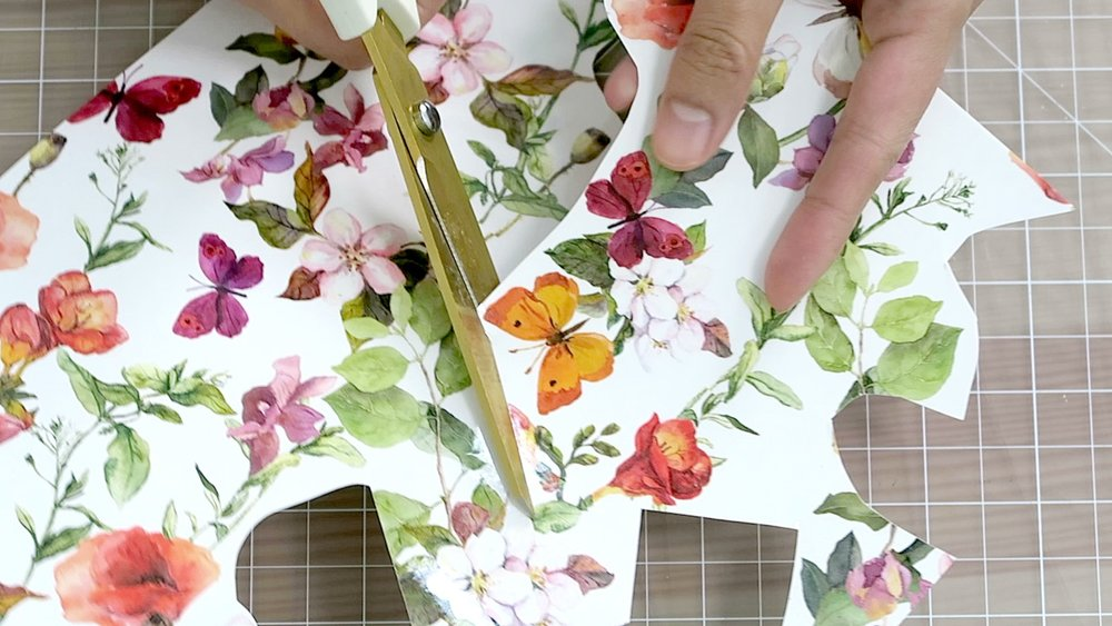 7) Print out vintage floral wall paper designs on to tattoo paper and cut out the designs.