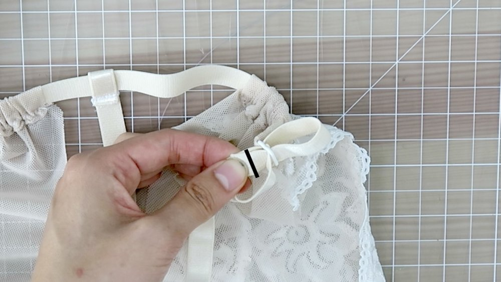 19) Slip on slider to the free end of the elastic; and sew to the ring on the bottom back strip. (Follow product instructions).