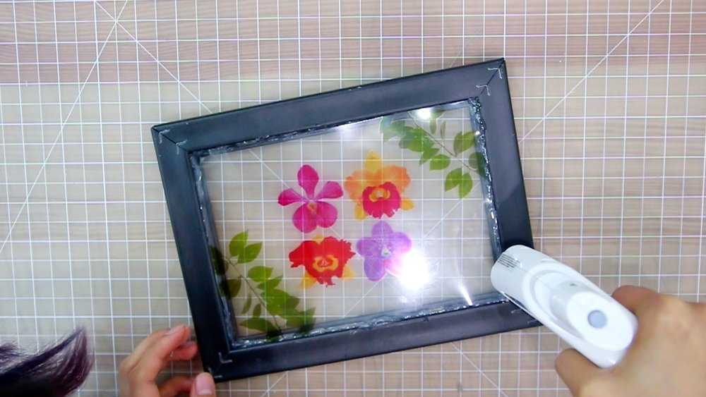 Go ahead and glue the edges so the image is secure inside the frame. Take are to no allow the glue to overflow otherwise, you can see the glue when you flip the frame over.