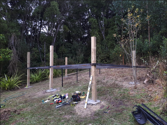 After cementing the posts in the ground we then secured the steel.