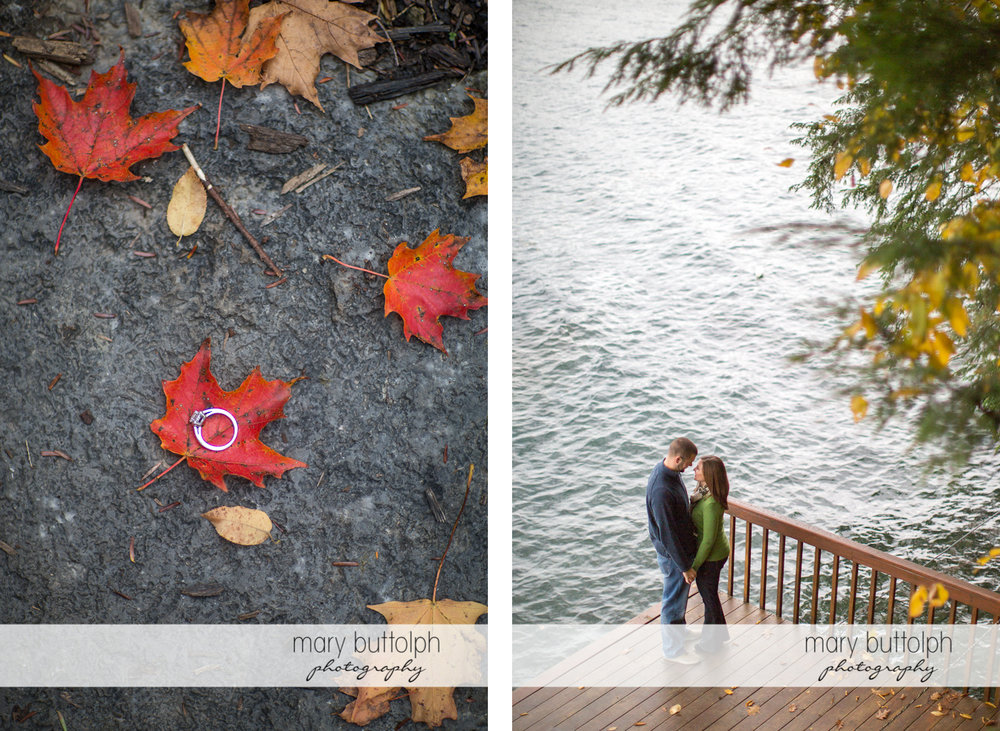Woman's engagement ring sits on a leaf while the couple stand near the lake at Skaneateles Engagement