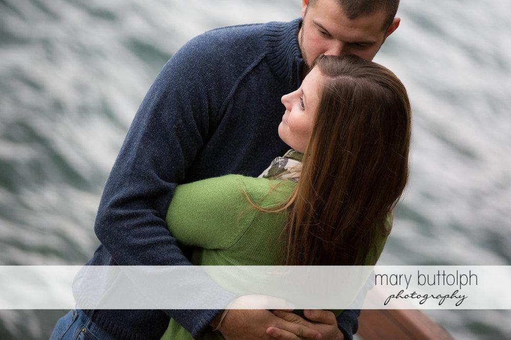 Couple get romantic near the lake at Skaneateles Engagement