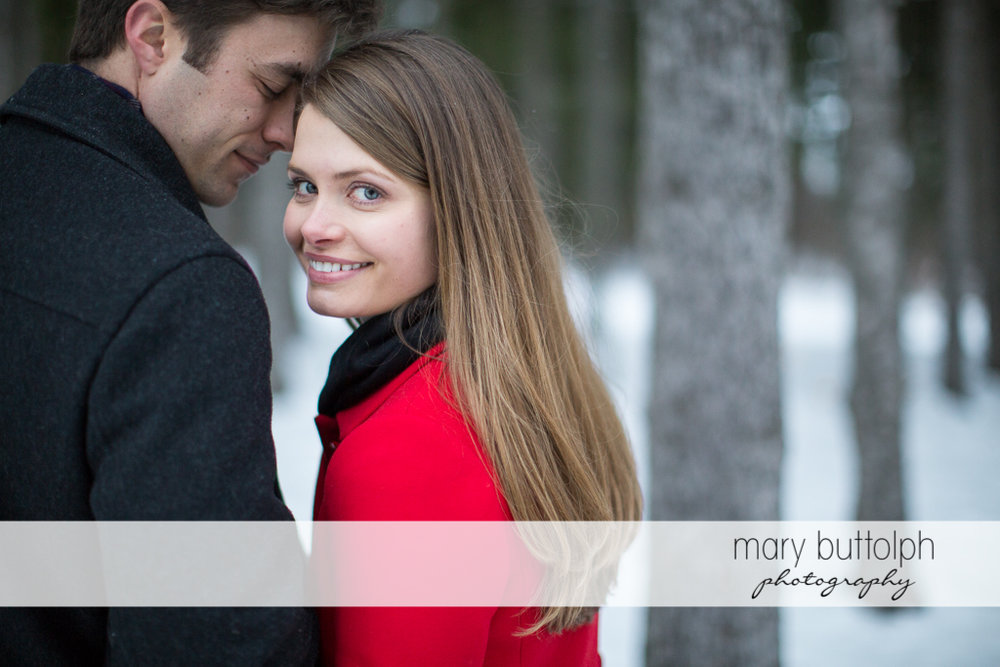 Couple pose for the camera in the park at Skaneateles Engagement