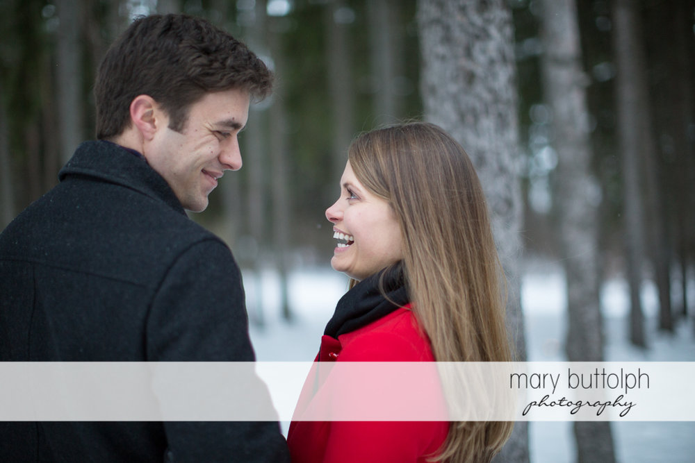 Couple face each other in the park at Skaneateles Engagement