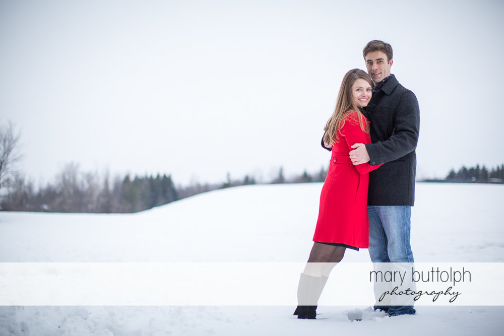 Couple don't mind the cold weather in the park at Skaneateles Engagement
