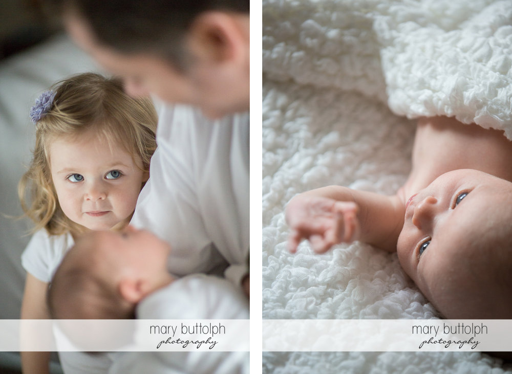 Girl listens to her dad who is carrying her new baby brother at Skaneateles Newborn Photography