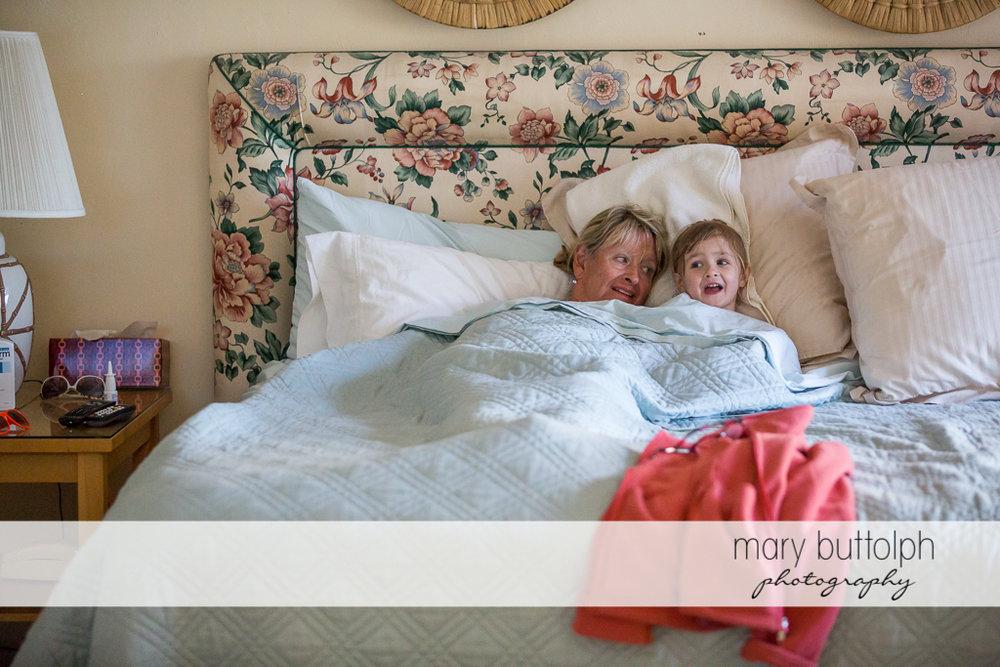 Girl shares blanket with her grandma at Sanibel Island Vacation