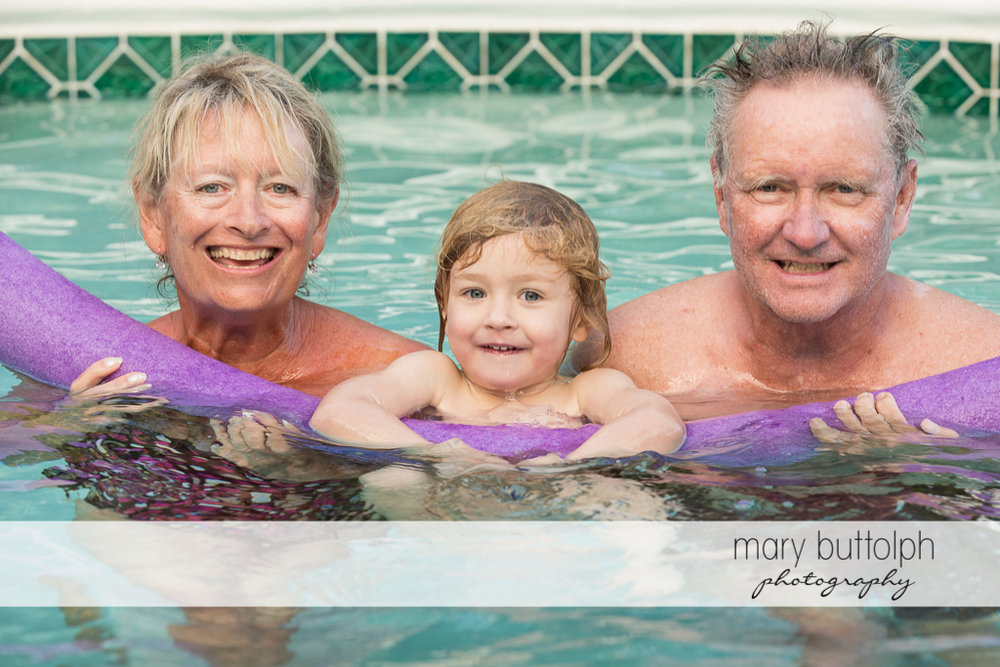 Couple and girl relax in the pool at Sanibel Island Vacation