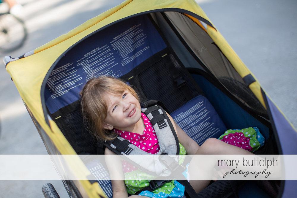 Girl rides in stroller at Sanibel Island Vacation