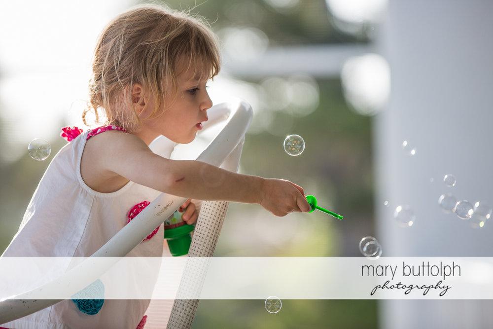 Girl makes bubbles at Sanibel Island Vacation