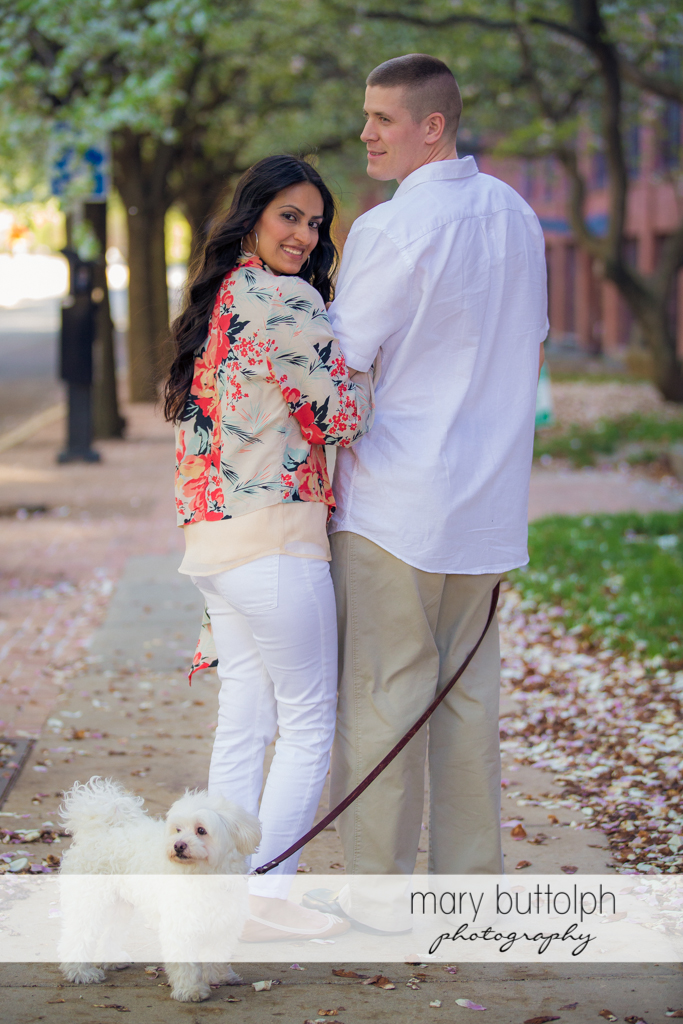 Couple stroll on the park with their pet dog at Franklin Square Engagement