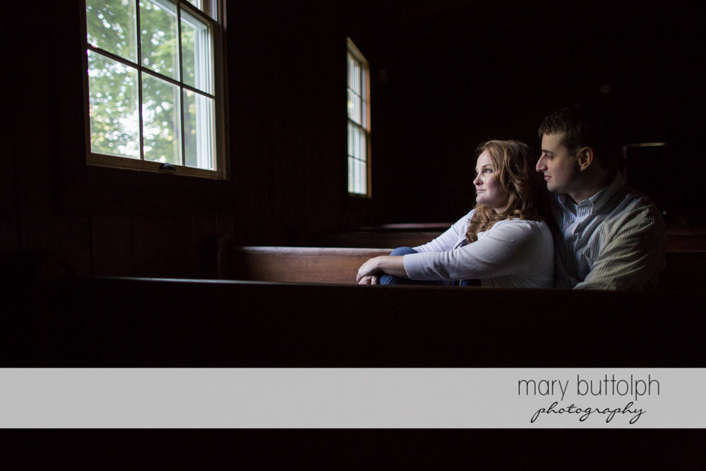Couple sit in the chapel at Lourdes Camp Engagement